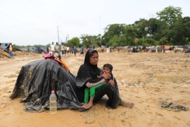 There is no easy way to end the suffering of the Rohingya in Myanmar, but it is imperative that the world speaks out as one against such atrocities, writes Yaqoob [Showkat Shafi/Al Jazeera]