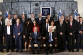 Members of the 34th government of Israel pose for a group photo at the presidential compound in Jerusalem on May 19, 2015 [Getty images]