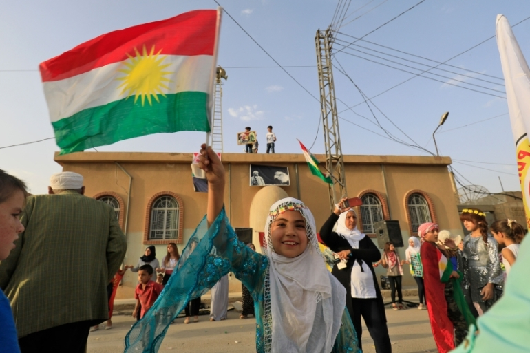 Kurdish-led authorities held a vote on Friday in northern Syria [Delil Souleiman/Getty Images]