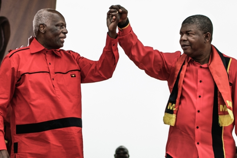 Lourenco takes over from dos Santos, left, who ruled Angola for almost four decades [Marco Longari/AFP]