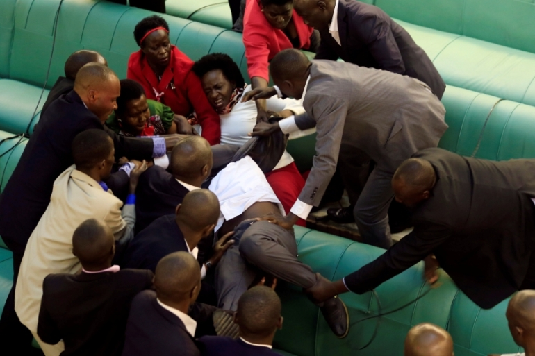 Fistfights erupted in parliament for the second day as MPs from the ruling party pushed for the bill to be introduced [James Akena/Reuters]