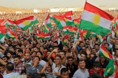 Kurdish people attend a rally to show their support for the upcoming September 25th independence referendum in Duhuk, Iraq September 16, 2017 [Ari Jalal/Reuters]