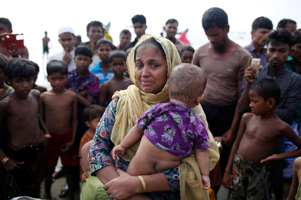 The journey has been tough and emotional for the estimated 270,000 that have crossed over into Bangladesh since August 25. [Mohammad Ponir Hossain/Reuters]