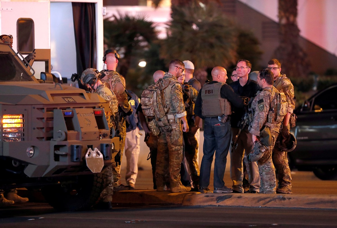 FBI agents confer in front of the Tropicana hotel-casino after a mass shooting during a music festival on the Las Vegas Strip in Las Vegas, Nevada, US. [Steve Marcus/Las Vegas Sun/Reuters]