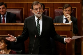 Spanish Prime Minister Mariano Rajoy answers a question in parliament in Madrid on Wednesday [Juan Medina/Reuters]