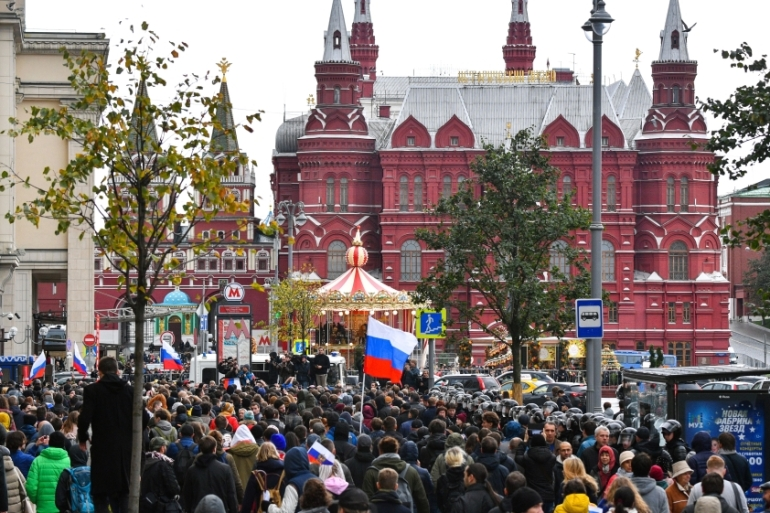 Demonstrators walk down Tverskaya Street towards the Kremlin during an unauthorised opposition rally called by Alexei Navalny in downtown Moscow on October 7 [AFP/Mladen Antonov]