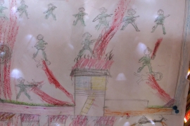 A Rohingya child's depictions of the violence he said soldiers in Myanmar carried out in his village [Annette Ekin/Al Jazeera]