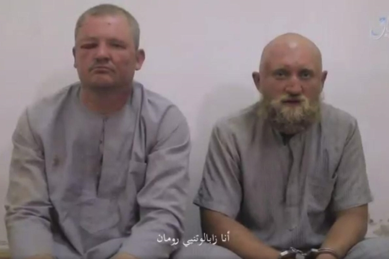 The two men could be Russian mercenaries, a researcher told Al Jazeera [Screenshot from Amaq]