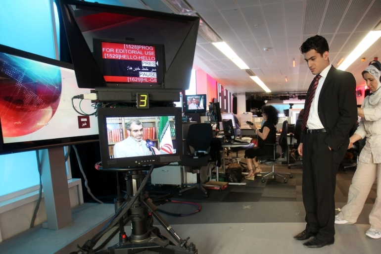 In this June 26, 2009 file photo a BBC Persian service presenter gets ready to present the news, at the corporation's London headquarters [Simon Dawson/AP]