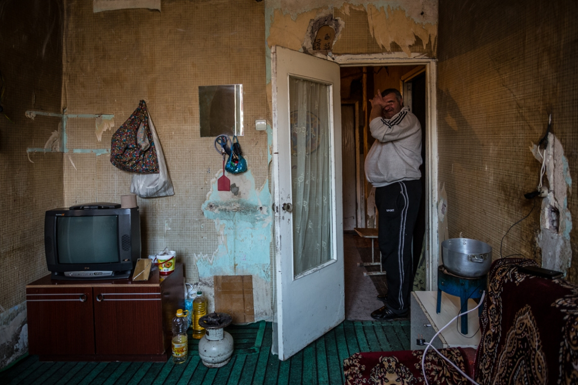 Knyaz, 38, is of Assyrian origin, one of the ethnic minorities of Armenia. He payed $300 to buy this apartment years ago. After he lost his wife to cancer, he says it was difficult for him to take care of his little daughter alone. [Yulia Grigoryants/Al Jazeera]