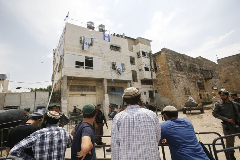 Israel is planning to build 31 housing units in the Beit Romano settlement in Hebron's Old City [Nasser Shiyoukhi/AP]