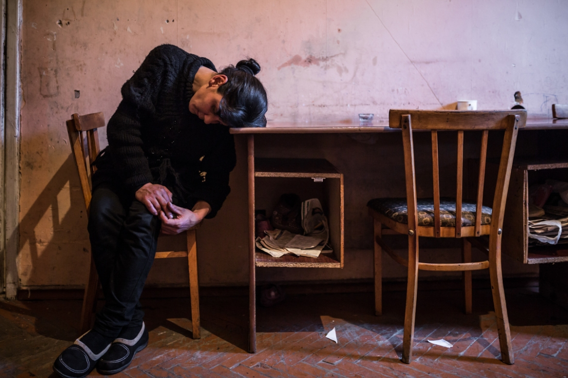 Lusine, Syuzanna's mother is 30 years old. With the suicide of her husband, she is now a single mother of five with little support. [Yulia Grigoryants/Al Jazeera]