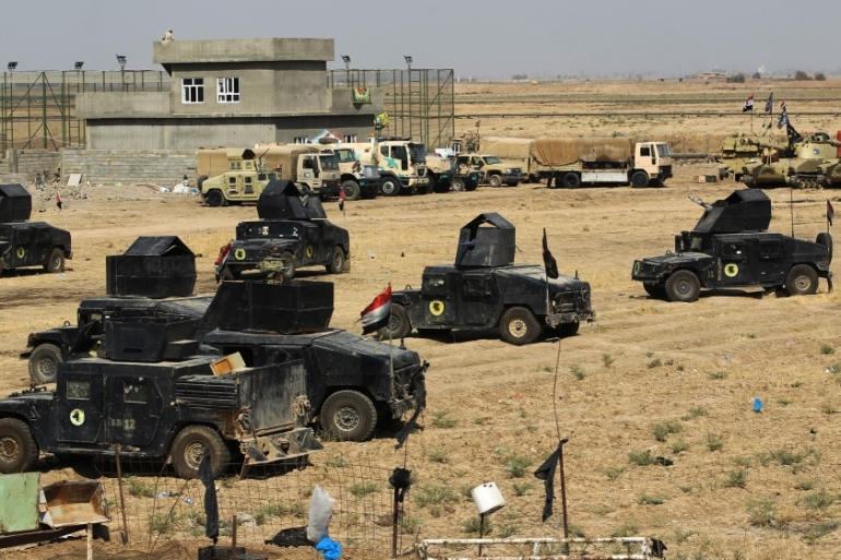Iraqi forces seen on Sunday in Taza Khormatu on the southern outskirts of Kirkuk [Ahmad al-Rubaye/AFP/Getty Images]