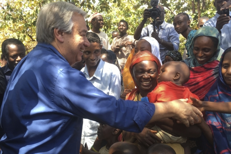 Guterres, left, shakes hands with people at Bangassou Cathedral Bangui, Central African Republic [Joel Kouam/The Associated Press]