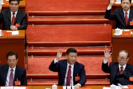 Xi, centre, was first elected as head of China's Communist Party in 2012 [Reuters]