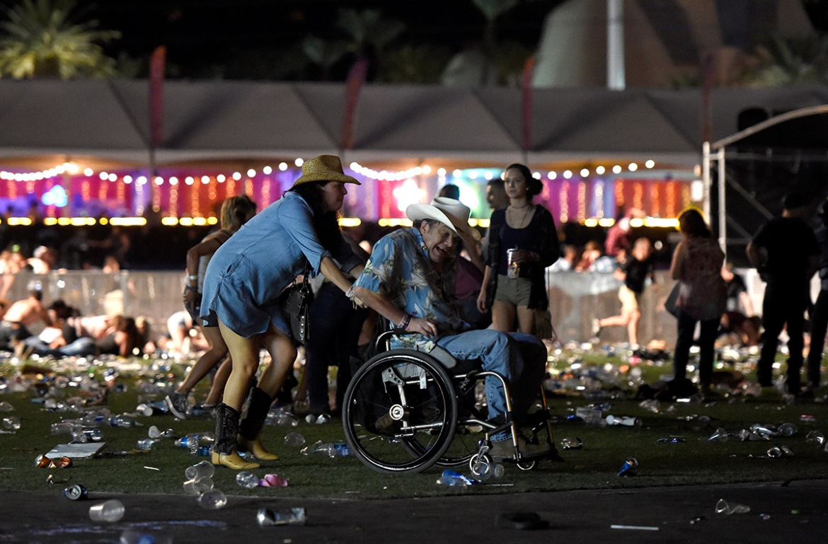 A man in a wheelchair is taken away from the Route 91 Harvest country music festival.[David Becker/Getty Images]