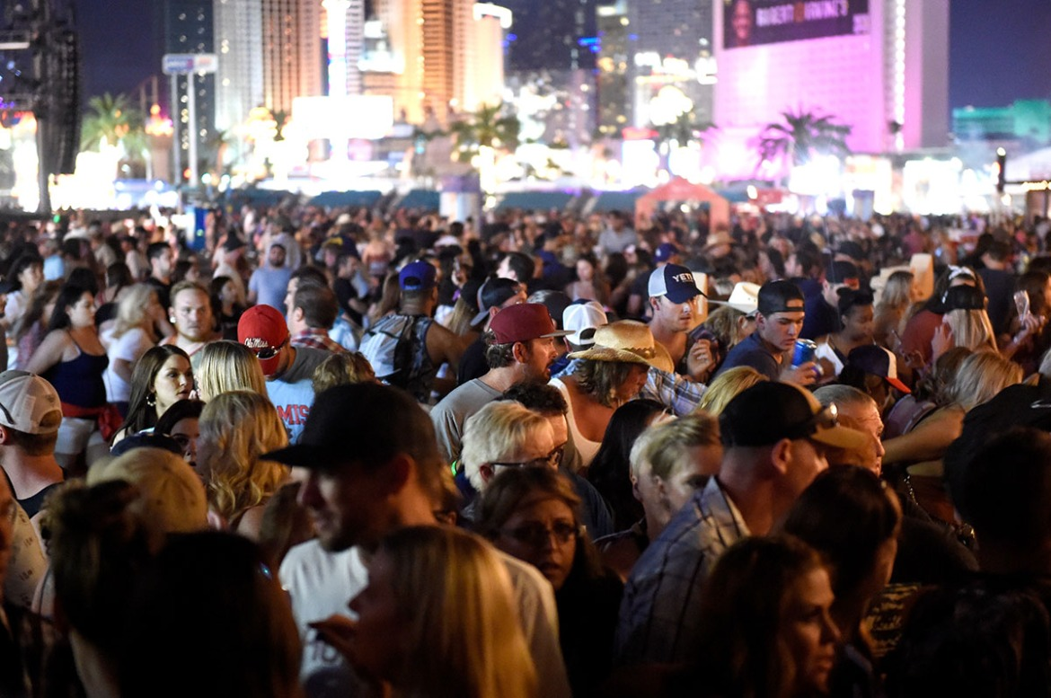 A crowd of people at the Route 91 Harvest country music festival after gunfire was heard in Las Vegas, Nevada. [David Becker/Getty Images]
