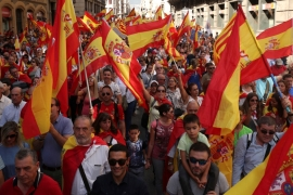 People wave Spanish and Catalan flags as they attend a pro-union demonstration in Barcelona, Spain, October 8, 2017 [Albert Gea/Reuters]