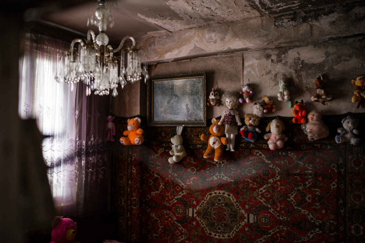 Since the apartments are very small, often a single room serves as a bedroom for the whole family. [Yulia Grigoryants/Al Jazeera]
