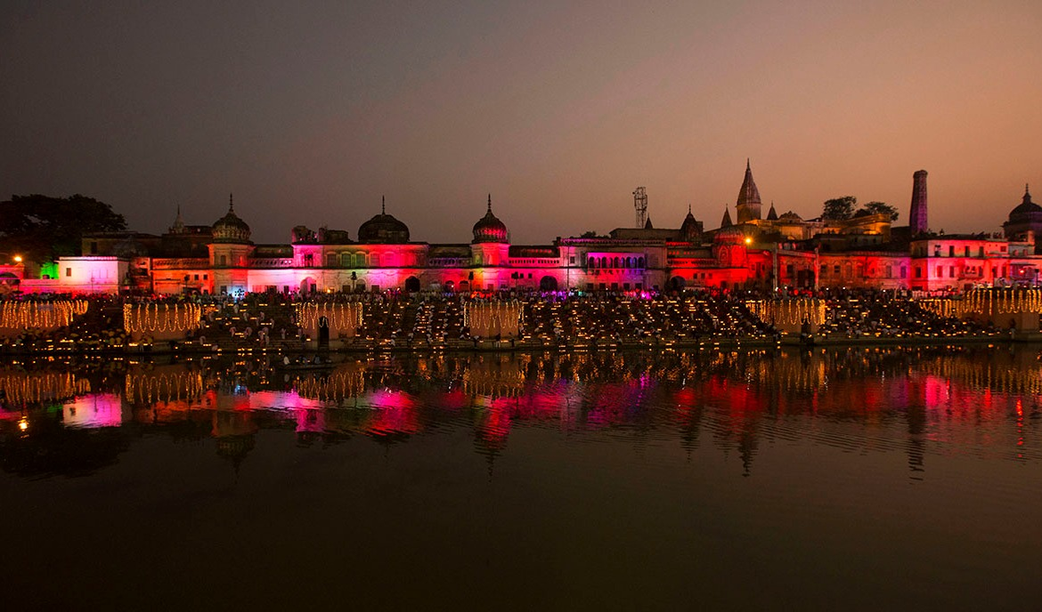 Devotees light masses of twinkling 'diyas', earthenware oil lamps, on the banks of the River Sarayu as part of Diwali celebrations in Ayodhya, India. Ayodhya is believed to be the birthplace of the Hindu god Ram. Diwali, the festival of lights, is celebrated in honour of the return of Ram and his wife Sita to Ayodhya after an exile of 14 years. [Nadeem Khan/AP Photo]