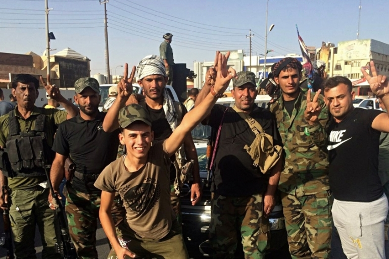 Iraqi security forces and volunteers celebrate in front of Governorate Council Building in Kirkuk, 290km north of Baghdad, Iraq, Monday, October 16, 2017 [Emad Matti/Iraq]
