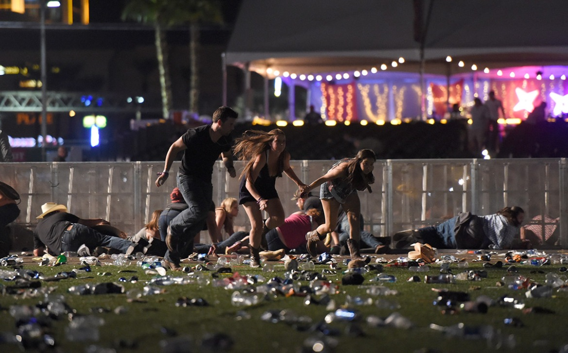 People run from the Route 91 Harvest country music festival after gunfire was heard. [David Becker/Getty Images]