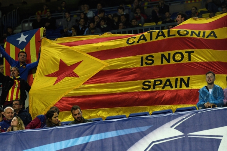 Catalonia protestors hold up a flag inside the stadium during the UEFA Champions League group D match between FC Barcelona and Olympiakos Piraeus [David Ramos/Getty Images]