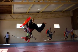Primary school children practise acrobatic moves during kung fu classes at the Amitofo Care Centre in Swaziland. [Cornell Tukiri/Al Jazeera]