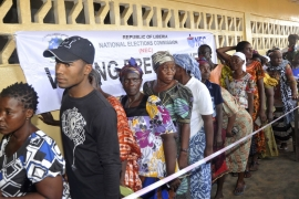 People wait to cast their votes during a presidential election in Monrovia, Liberia on October 10 [File: AP Photo/Abbas Dulleh]