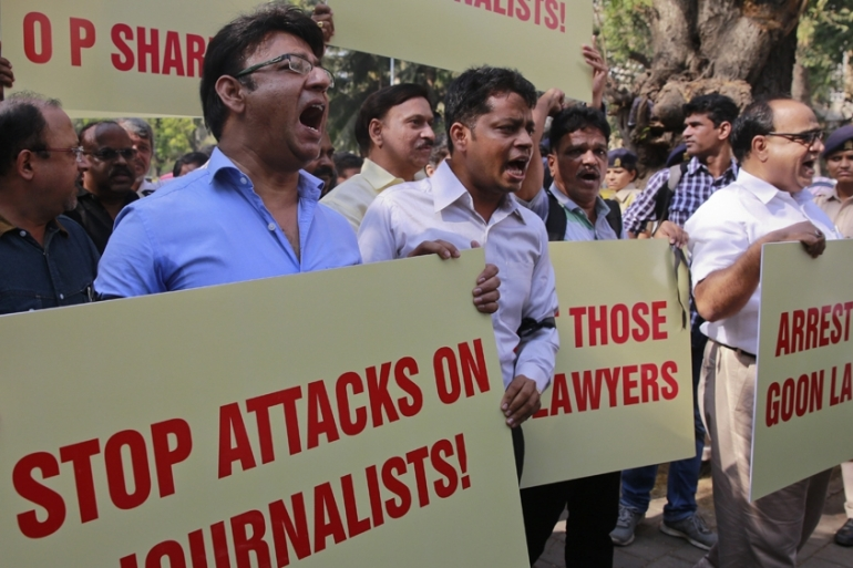 The IFJ says more than 250 journalists are in jail across the world [AP]