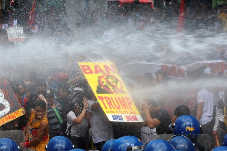 Protesters are hosed with water cannon as they clash with police during a rally against US President Donald Trump, who is attending the Association of Southeast Asian Nations (ASEAN) Summit. REUTERS [Reuters]