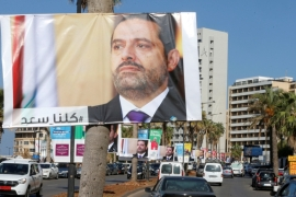 Posters depicting Lebanon's Prime Minister Saad al-Hariri, who has resigned from his post, line up a street in Beirut. The inscription on the poster says 'we are all with you' [Reuters/Mohamed Azakir]