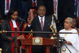 Kenya's President Uhuru Kenyatta takes oath of office during inauguration ceremony at Kasarani Stadium in Nairobi on November 28 [Reuters/Thomas Mukoya]