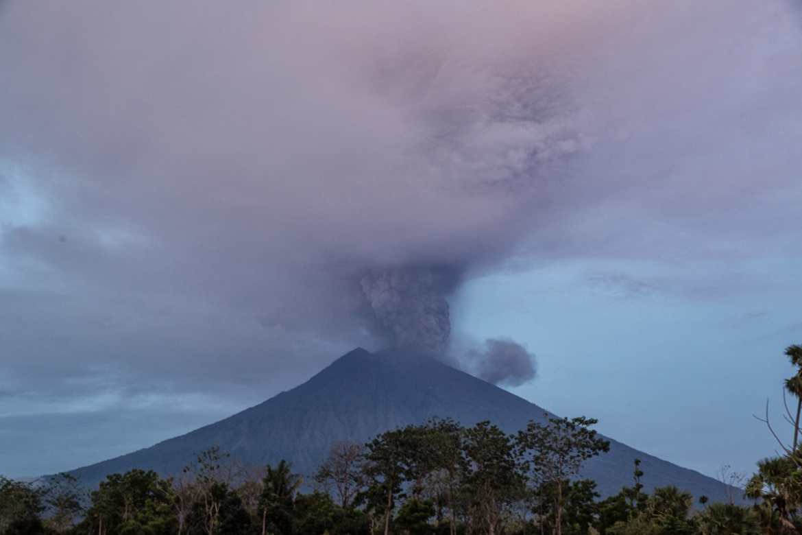 Indonesia's Mount Agung volcano erupts for a second time in less than a week as seen from Datah village in Karangasem, Bali. [Putu Sayoga/Al Jazeera]