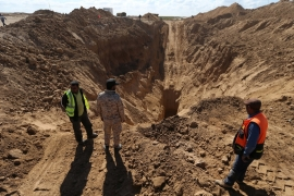 Rescue workers in Gaza searched for missing Palestinians after Israel blew up a cross-border tunnel in Khan Younis [braheem Abu Mustafa/Reuters]
