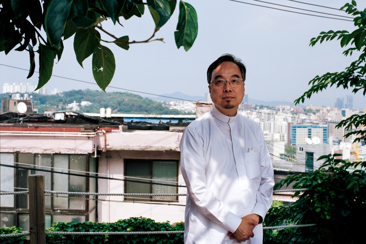 "It was difficult at first for Imam A. Rahman Lee Ju-Hwa, who was introduced to Islam in 1984, to tell his friends that he could not meet for barbecue and drinks. ""Back in the day, my friends didn't understand my religion and forcibly asked me to drink,"" he said. ""It took some time but today they understand me."" Imam Lee looks back at the Korean hostage crisis and recalls a time when local police were stationed in front of the mosque to protect it from protests and bomb threats as a reaction to the kidnappings. ""The Korean hostage crisis was one critical point in the history of Islam in South Korea,"" Lee says. [Radu Diaconu/Al Jazeera]"