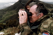 Ratko Mladic monitors a battle from his shelter on top of a hill some 4km from the centre of the eastern Bosnian city of Gorazde on April 16, 1994 [Reuters]