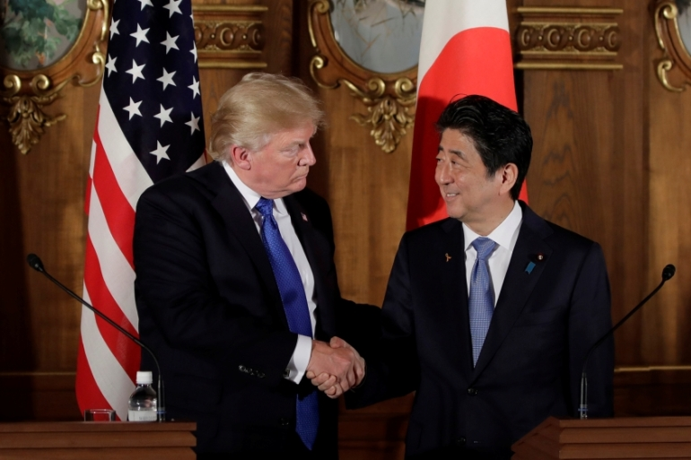 U.S. President Donald Trump, left, shakes hands with Shinzo Abe, Japan's prime minister, during a news conference at Akasaka Palace in Tokyo, Japan, November 6, 2017.   REUTERS/Kiyoshi Ota/Pool [Reuters]