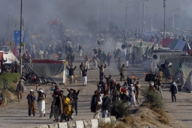 Police fire tear gas shells to disperse protesters during clashes in Islamabad, Pakistan on November 25 [AP/Anjum Naveed]