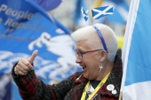 A woman gestures at a pro Independence rally held outside the SNP conference in Glasgow, Scotland in October, 2016 [Russell Cheyne/Reuters]