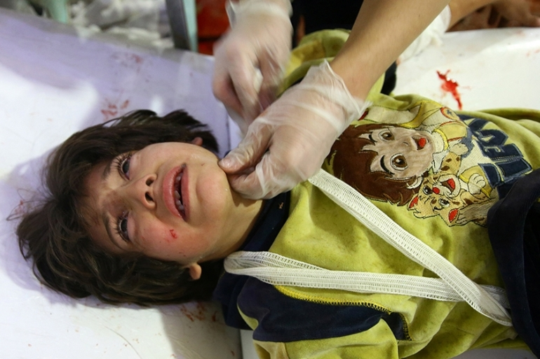 A wounded boy in a hospital in Douma after an airstrike on the town of Mesraba, eastern Ghouta [Bassam Khabieh/Reuters]