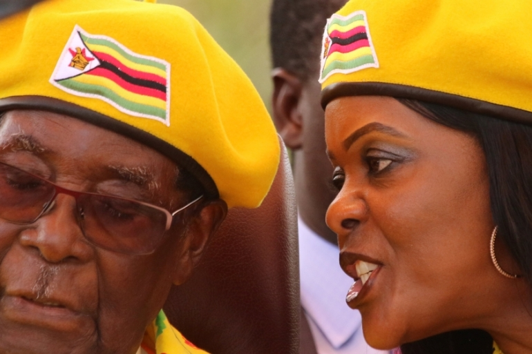Robert Mugabe and his wife, Grace, at a rally in Harare [File: Philimon Bulawayo/Reuters]