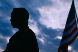 Silhouette of a US soldier with the American flag [Getty Images]