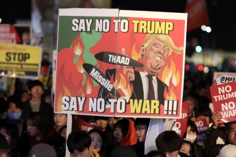 South Korea protest against Trump [Jonathan Ernst/Reuters]