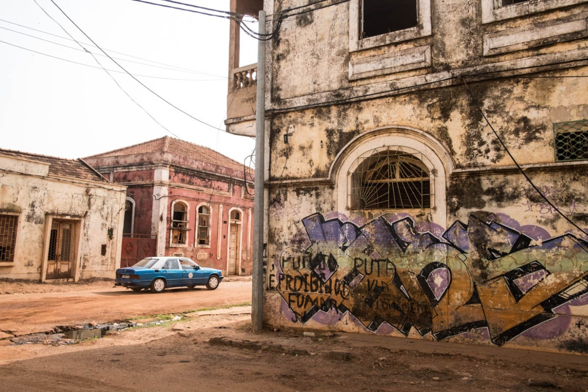 The heart of 'Bissau Velho' or Old Bissau, is mostly abandoned buildings, though some businesses and pharmacies operate out of the colonial era buildings. Bissau was named the capital in 1939 by the then colonial power, Portugal. [Ricci Shryock/ Al Jazeera]