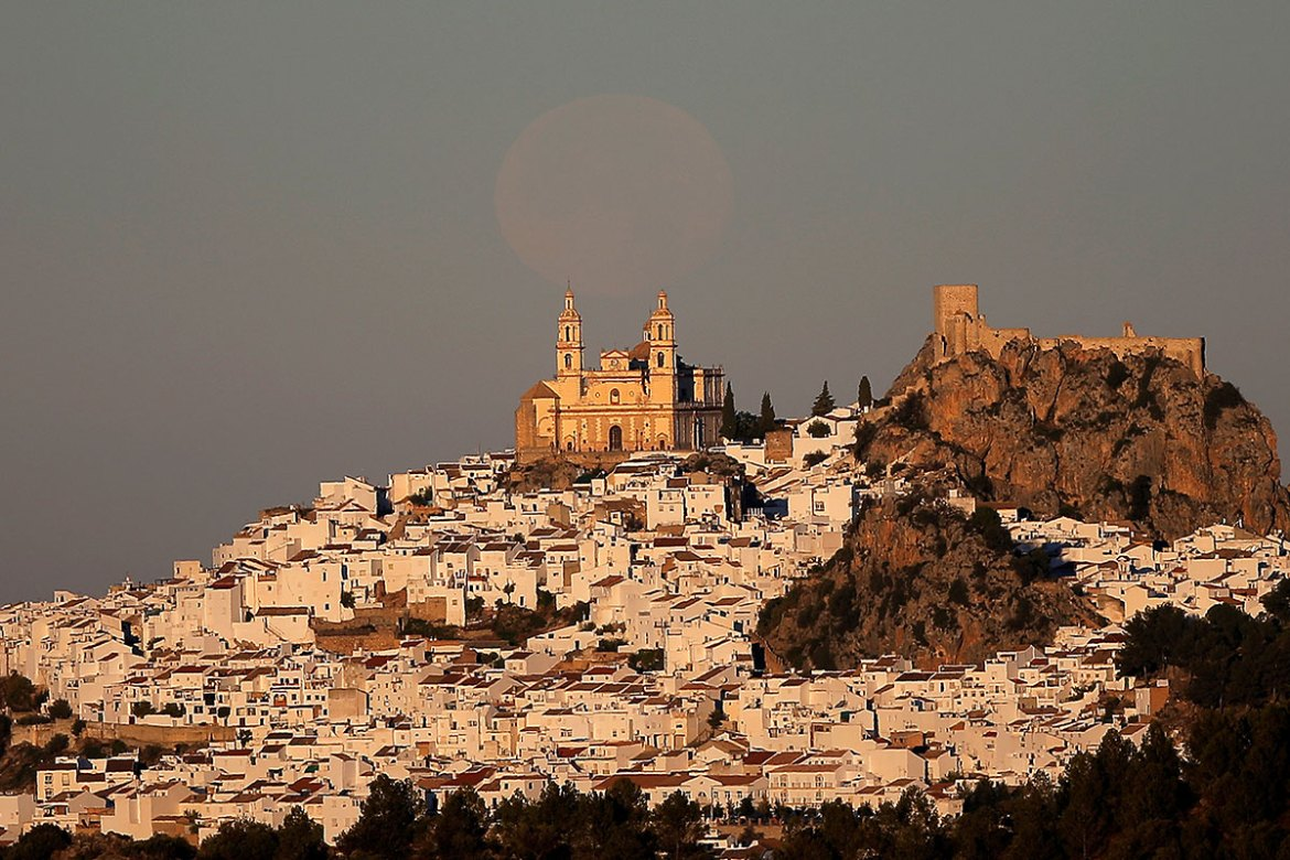 The supermoon rises before the sun has set in Olvera, southern Spain. [Jon Nazca/Reuters]