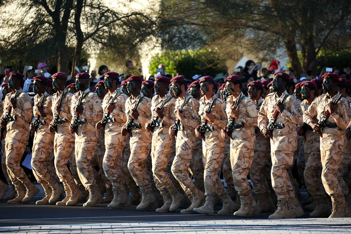 Members of the Qatari armed forces parade during the National Day. [Showkat Shafi/Al Jazeera]