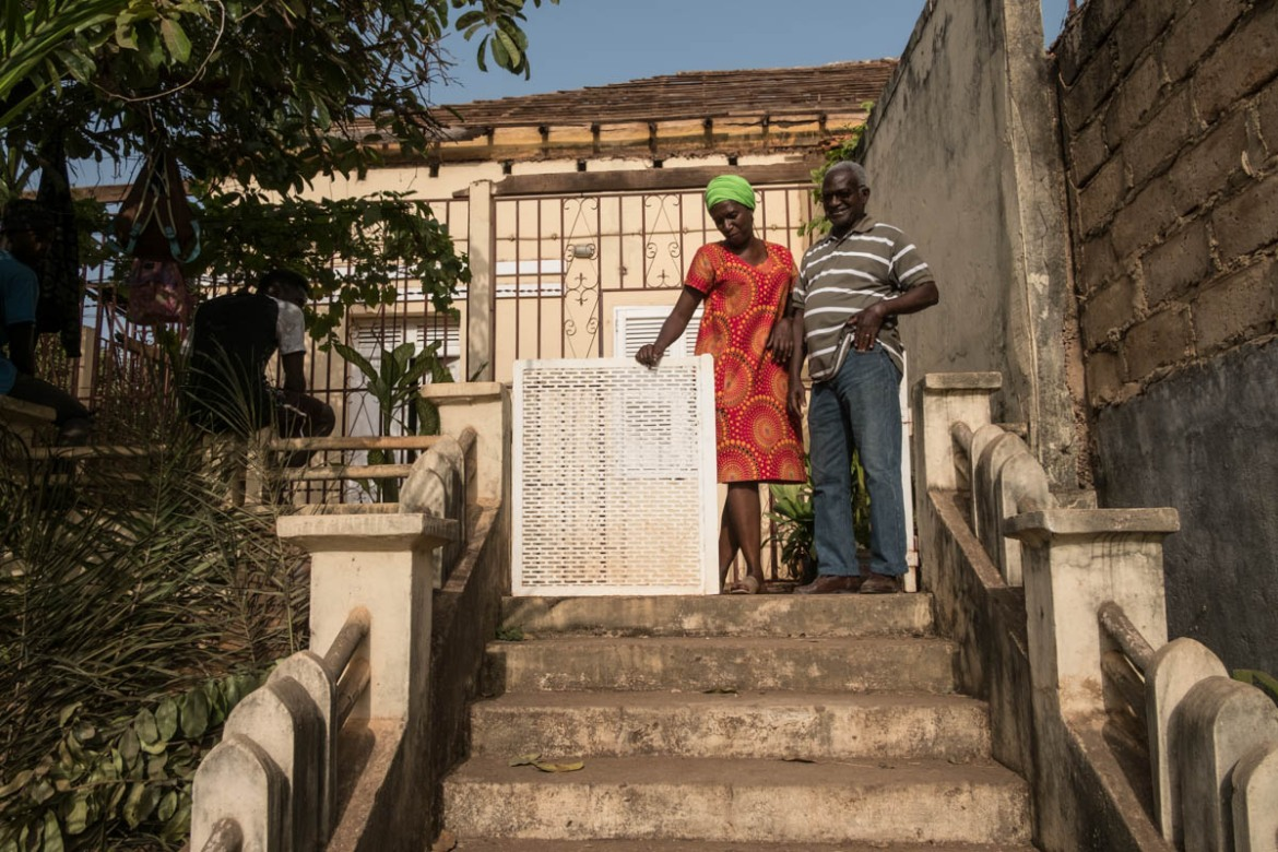 Joao Arlene da Costa (pictured here with architect Djamila Gomes) is restoring his colonial era home to its original state. He wants to see it in its former glory [Ricci Shryock/ Al Jazeera]