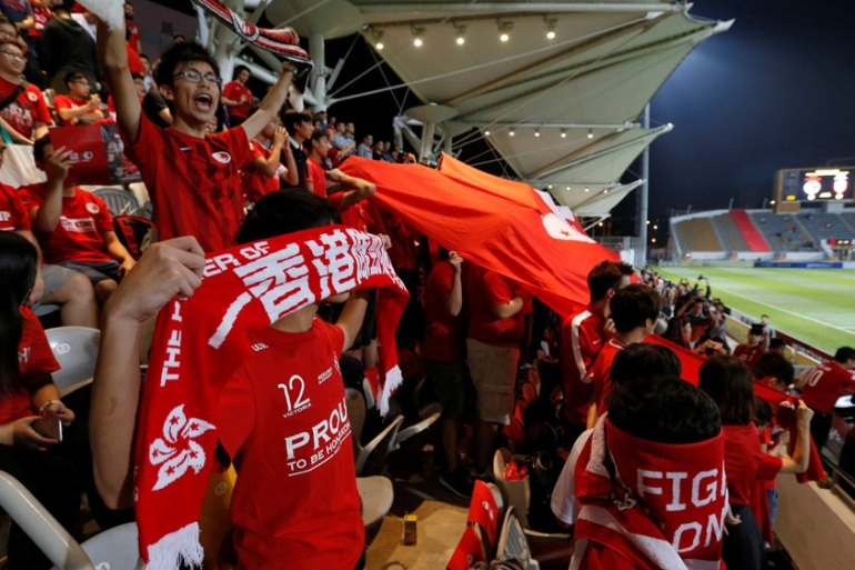 Fans boo - and hide - during China's national anthem at a football match between Hong Kong and Bahrain last month [Bobby Yip/Reuters]