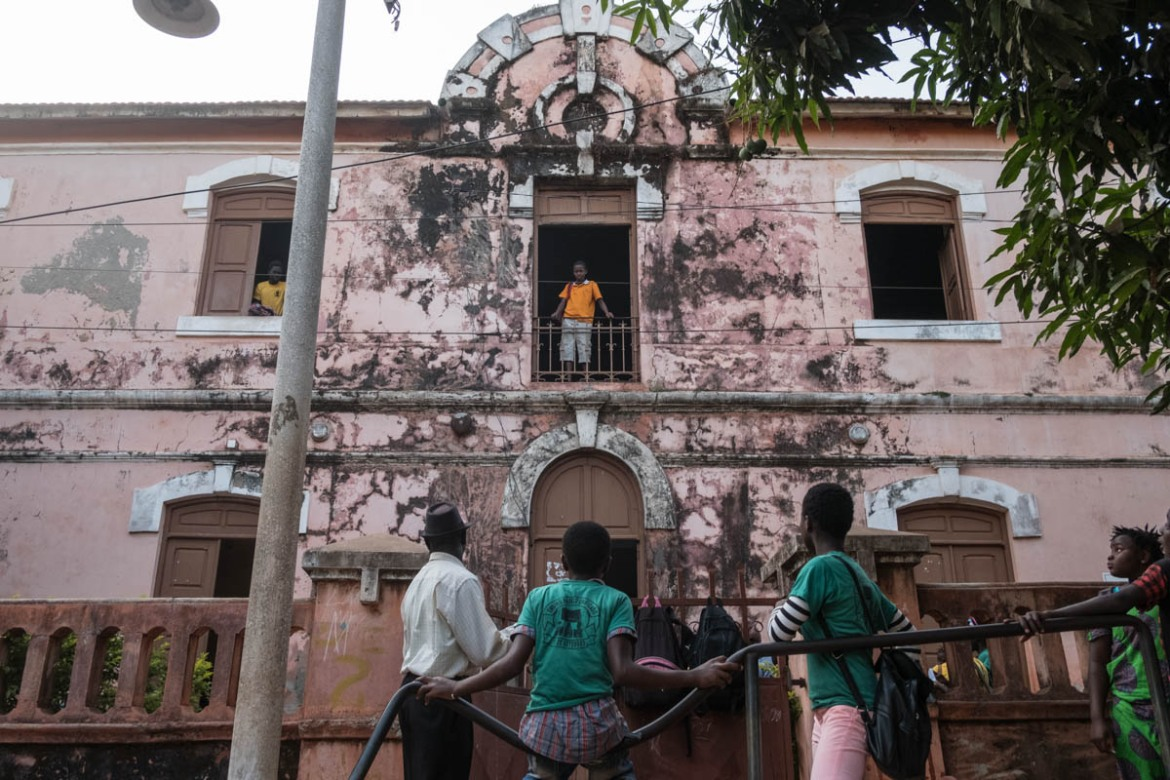 One of the first schools in Bissau, built in the early 1920s, this building still functions as a school. [Ricci Shryock/ Al Jazeera]